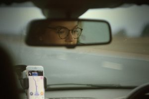 woman's reflection in rearview mirror