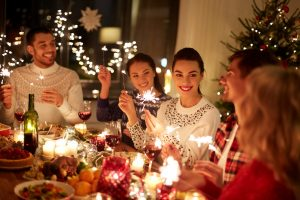 Family & friends together at table for holiday meal