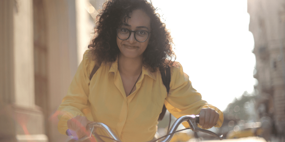 young-woman-glasses-yellow-smiling-facebook-ad-1000x500