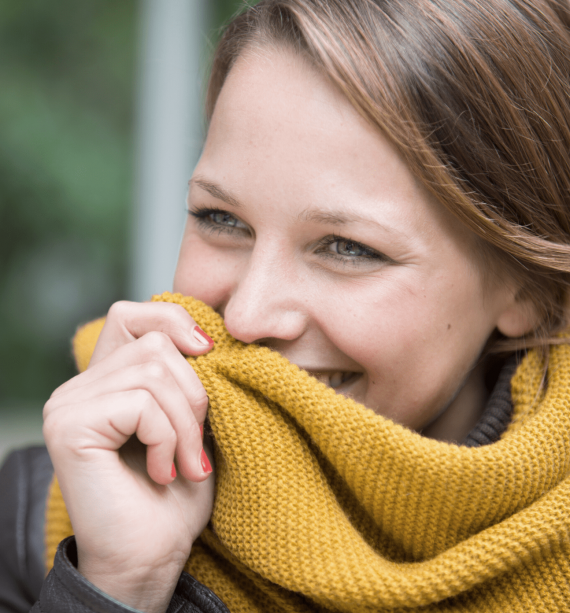 woman in a yellow scarf, smiling